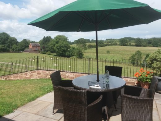 Patio area with table & chairs and a great view over the fields