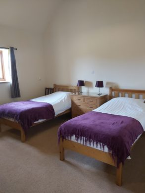 large bedroom with two single beds