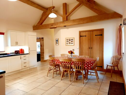 spacious kitchen with exposed beams in Shropshire holiday cottage