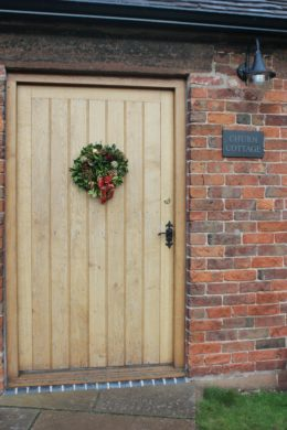front door with Christmas wreath churn cottage